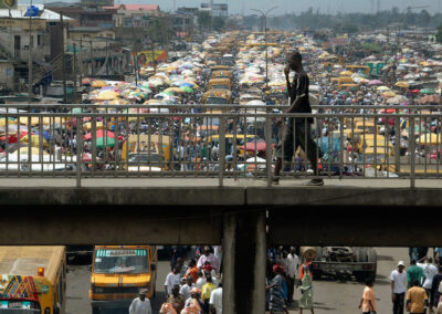 Man walks on pedestrian bridge in Lagos Nigeria